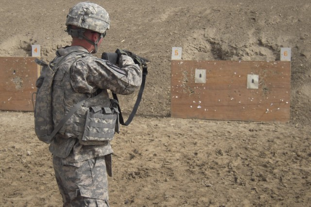BAGHDAD, Iraq-A Trooper with the 6th Squadron, 9th Cavalry Regiment, attached to 2nd Advise and Assist Brigade, 1st Infantry Division, United States Division - Center, fires a non-lethal round out of his M870 shotgun Feb. 23.