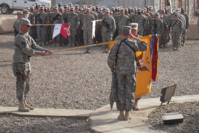 BAGHDAD, Iraq -Lt. Col. Cameron Cantlon, commander of 6th Squadron, 9th Cavalry Regiment, 2nd Advise and Assist Brigade, 1st Infantry Division, United States Division - Center, and Command Sgt. Maj. Richard Burnette salute the unit's colors Feb. 23 during the uncasing ceremony at Camp Liberty, Iraq.