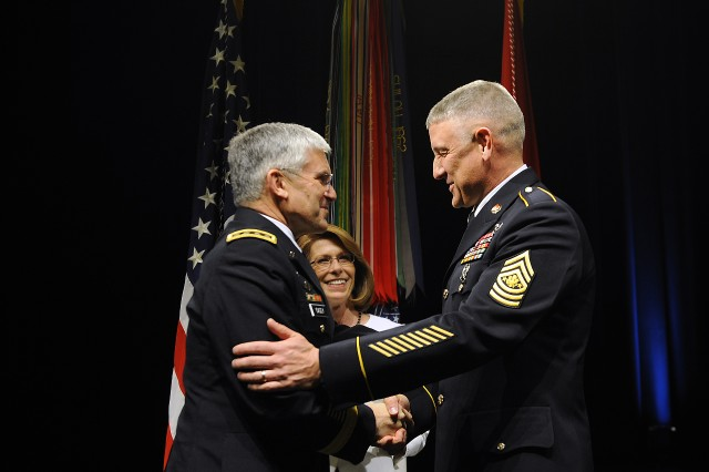 Chief of Staff of the Army Gen. George W. Casey Jr. congratulates Sgt. Maj. Raymond F. Chandler III after swearing him in as the 14th sergeant major of the Army during a ceremony, March 1, at the Pentagon. Chandler's wife, Jeanne, stands by before