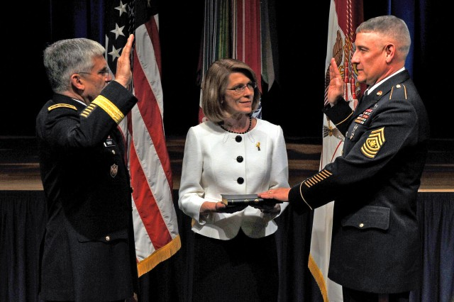 Chief of Staff of the Army Gen. George W. Casey Jr. swears in Sgt. Maj. Raymond F. Chandler III as the 14th sergeant major of the Army during a ceremony, March 1, at the Pentagon. Chandler's wife, Jeanne, holds the Bible during the ceremony.