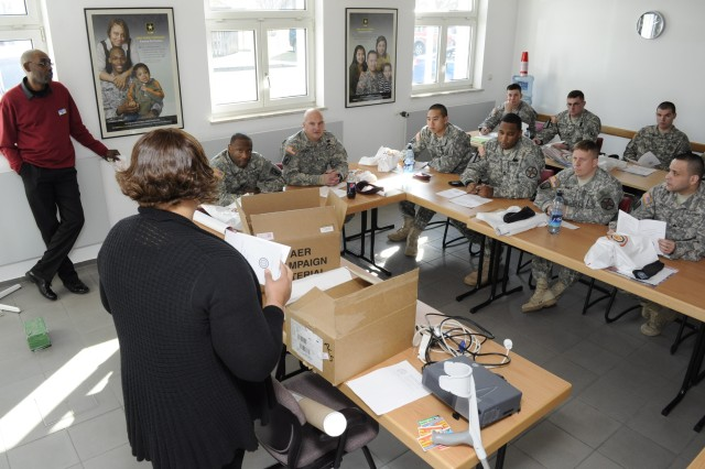 Vanessia Holland, an Army Emergency Relief manager for U.S. Army Garrison Bamberg's Army Community Service, speaks to unit representatives during AER training in Bamberg Feb. 28.