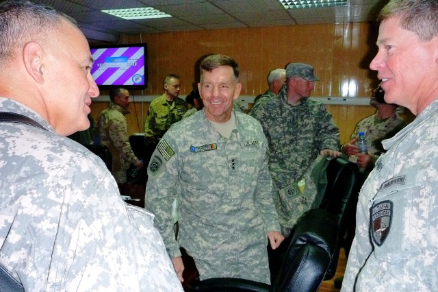 Lt. Gen. William B. Caldwell IV, commanding general of NTM-A/CSTC-A (center), listens to Brig. Gen. Guy T. Cosentino (left), new DCOM-RS, as Brig. Gen. John J. McGuiness, the first DCOM-RS, also listens, after the Commander's Update Brief at Camp Eggers, Kabul, Afghanistan on March 2.