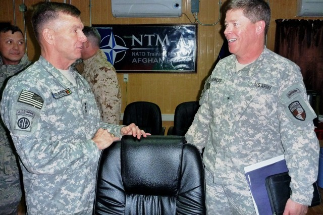 Lt. Gen. William B. Caldwell IV, commanding general of NATO Training Mission-Afghanistan and Combined Security Transition Command-Afghanistan (left), and Brig. Gen. John J. McGuiness, the first deputy commander of Regional Support (DCOM-RS), NTM-A/CSTC-A, share a light moment immediately following the Commander's Update Brief at Camp Eggers, Kabul, Afghanistan on March 2.