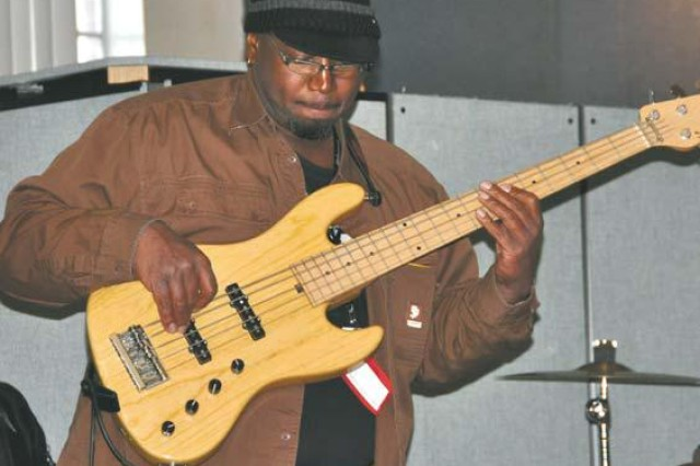 Buddy Jordan performs a solo on bass while leading his jazz band, Buddy Jordan's Beyond Blue, for the Open Mic audience.