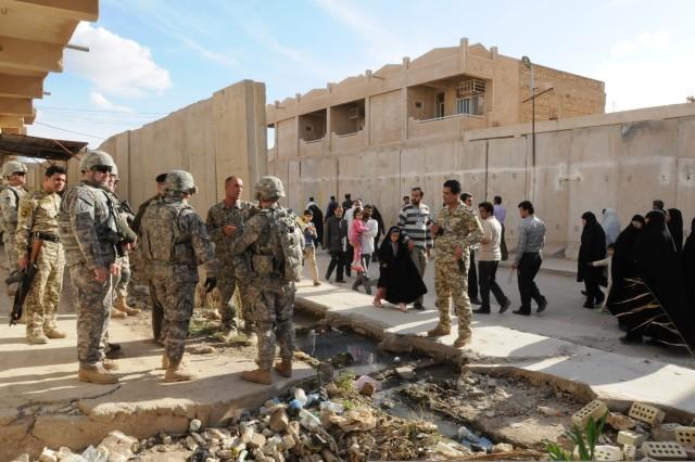 Walls come down in Samarra, Iraq