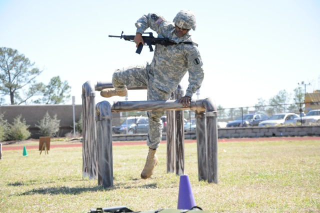 Sgt. 1st Class Cornelius Trammell, with the Army Physical Fitness School, navigates the high crawl obstacles of the Army Combat Readiness Test lane Tuesday during a demonstration at the Drill Sergeant School. The ACRT is one of two new tests proposed to replace the Army Physical Fitness Test as early as next year.