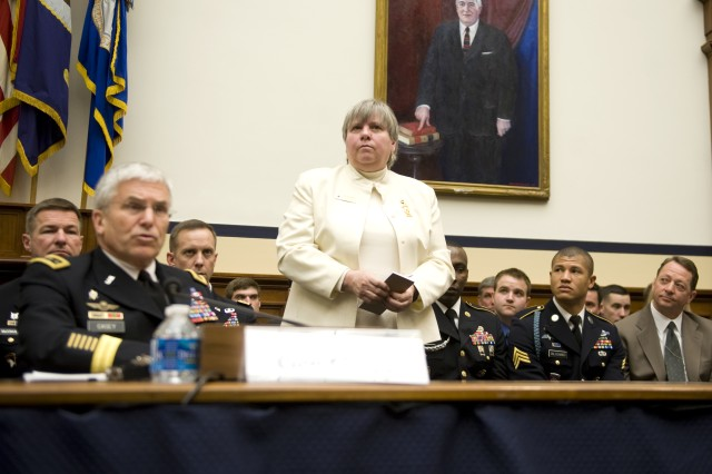 Gold Star Mother, Ruth Stonesifer, is introduced as a guest of the Army by Army Chief of Staff Gen. George W. Casey Jr. during a House Armed Services Committee hearing In Washington DC on Mar. 2, 2011. Ms. Stonesifer's son was killed in a helicopter crash along the Afghan-Pakistan border while conducting search and rescue in Oct. 2001.