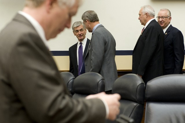 Secretary of the Army John McHugh talks with members of the House Armed Services Committee prior to a hearing on Capitol Hill Mar. 2, 2011.  The committee is hearing testimony on the FY2012 budget request from the Department of the Army.