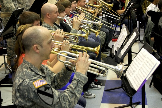 ANCHORAGE -- Soldiers of U.S. Army Alaska's 9th Army Band interact with band students during a music clinic at East High School here Feb. 25.