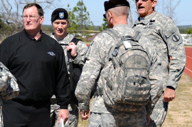 Frank Palkoska (left), director of the U.S. Army Physical Fitness School at Fort Jackson, S.C., and Lt. Gen. Mark P. Hertling (right), deputy commanding general at Training and Doctrine Command for Initial Military Training, watch as the new Army Physical Readiness Test is unveiled for the first time.