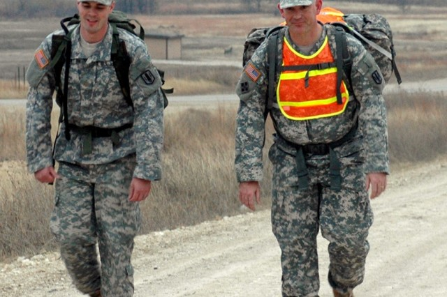 FORT HOOD, Texas-Maj. Raymond Jones (right), of Glenrose, Texas, and 2nd Lt. Nicholas Hughes focus on the walk during their 22 mile ruck march on the tank trail here, Feb. 23. The Soldiers are practicing for the 22nd annual Bataan Memorial Death March, which is a 26.2 mile ruck march scheduled in White Sands Missile Range, N.M.