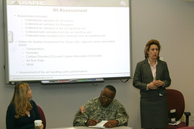 Bethney Davidson (right), risk communication specialist for the Army Public Health Command, spoke at an employee information session held at Army Sustainment Command's G3 training room on March 2. Davidson, who was part of a team of experts who sampled and analyzed air quality in Building 350 in January, explained the sampling methods and standards. Lindsey Kneten (left), USAPHC's Army Institute of Public Health industrial hygienist, and Col. Richard Dix, ASC chief of staff, also participated in the information session.
