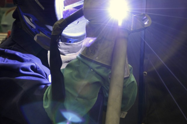 Arsenal welder Marvin Hunter works on the support leg for a 120mm mortar system.  This is a new product line for the Watervliet Arsenal.