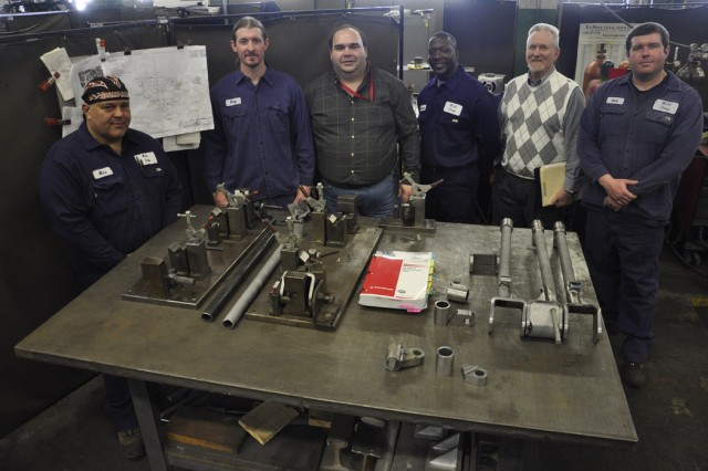 The team of planners and welders who were key to obtaining a new $750,000 order for 120mm support legs.  From left, welder Mike Degrenier, lead welder Greg Stone, planner Danny Weatherwax, welder Marvin Hunter, planner Tim Marquise, and welder Rob Hadeka.