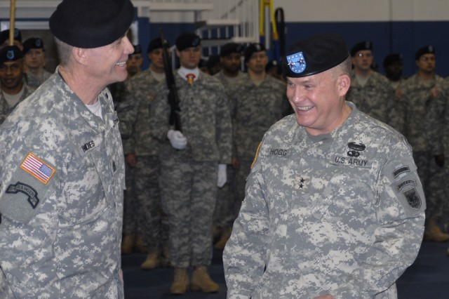 Command Sgt. Maj. Hu Rhodes (left) and Maj. Gen. David R. Hogg share a light moment before the Assumption of Responsibility ceremony Feb. 17 in Vicenza, Italy.