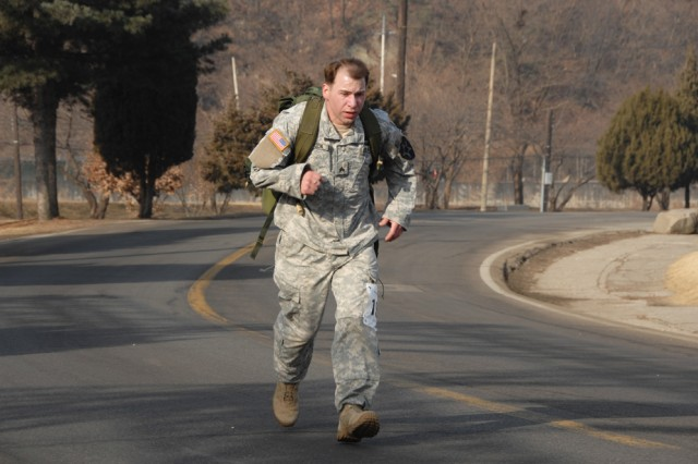 CAMP CASEY, South Korea - Jeffrey Hayden, Headquarters and Headquarters Company, 2nd Battalion, 9th Infantry Regiment, distances himself from the pack before successfully defending his 2010 men's division title. Battling the flu and admittedly without adequate time to train, Hayden finished the 13.1 mile course in 2:03:34, well short of his course record time of 1:55:53 set last year.