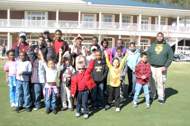 Children cheer after completing their first lesson of golf from First Tee of Atlanta Feb. 26 on the golfing greens at The Commons at Fort McPherson. The class, which teaches golf and life skills, was attended by 29 children.