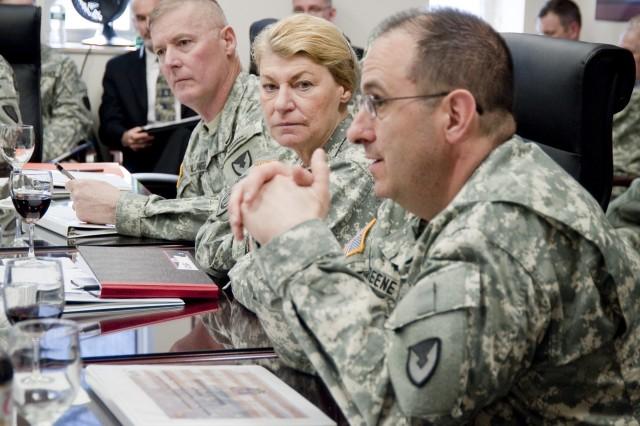 Gen. Ann Dunwoody, commanding general, U.S. Army Materiel Command, listens as Brig. Gen. Harold Greene, senior commander, Natick Soldier Systems Center, speaks during Dunwoody's March 3 visit to NSSC.