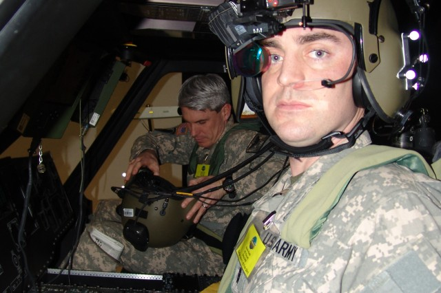 Chief Warrant Officer 3 Kevin Keith, a Kentucky National Guard Aviator, wearing a tactical situational awareness system waist belt, shoulder straps and seat pan waits as Chief Warrant Officer 2 Justin Frye completes suiting up for one of their organization's 36 record-setting mission runs conducted over an aggressive two-week period.  During these two weeks, they tested four of the Air Soldier System situational awareness technologies in support