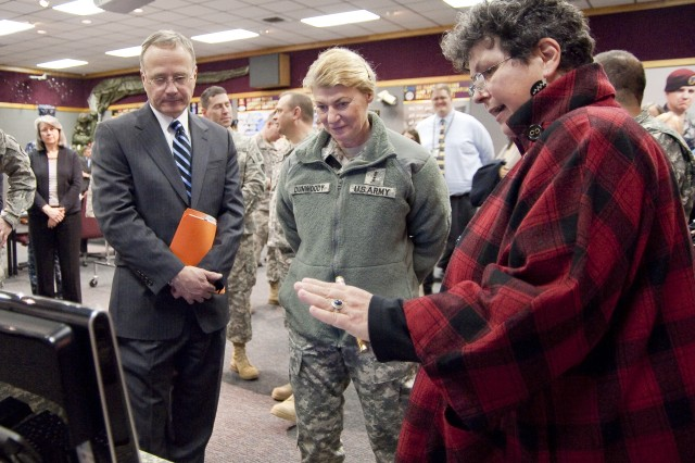 """During her March 3 visit to Natick Soldier Systems Center, Gen. Ann Dunwoody received a series of briefings.  She is accompanied here by Dr. John P. """"Jack"""" Obusek, director, Natick Soldier Research, Development and Engineering Center."""