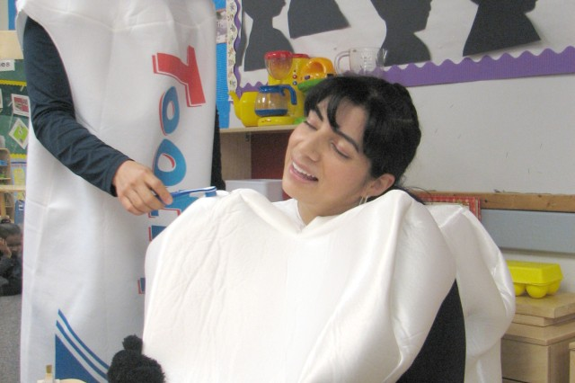 Lobos smiles as Marcucci demonstrates proper brushing technique: slow, gentle, circular motions. Proper brushing technique, at least twice a day, can help prevent cavities and promotes good oral hygiene, said Lobos.
