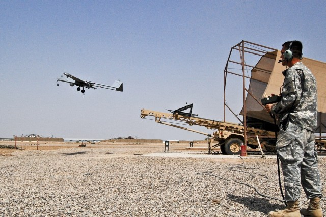 Spc. Raymond Poltera, a Tactical Unmanned Aerial Vehicle operator with 1st Brigade Combat Team, 4th Infantry Division, launches an RQ-7B Shadow 200 at Camp Taji, Iraq. The Shadow provides commanders on the ground throughout the area of operations the ability to see the over-the-horizon battlefield.