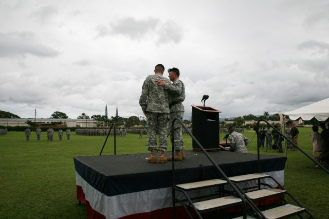 Lt. Gen. Benjamin R. Mixon (right), U.S. Army Pacific commander, talks with Col. Richard Kim, 3rd Brigade Combat Team commander, after the 3rd BCT's deployment ceremony March 4 at Schofield Barracks, Hawaii.  Families were invited to join Soldiers on the field after the deployment ceremony.  The 3rd BCT will deploy soon to Afghanistan.