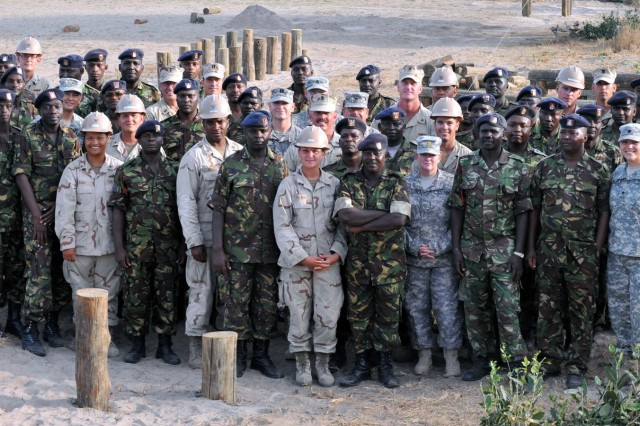 Kenyan and American military members gather for a completion ceremony at the end of five weeks of civil-military operations training in Manda Bay, Kenya.