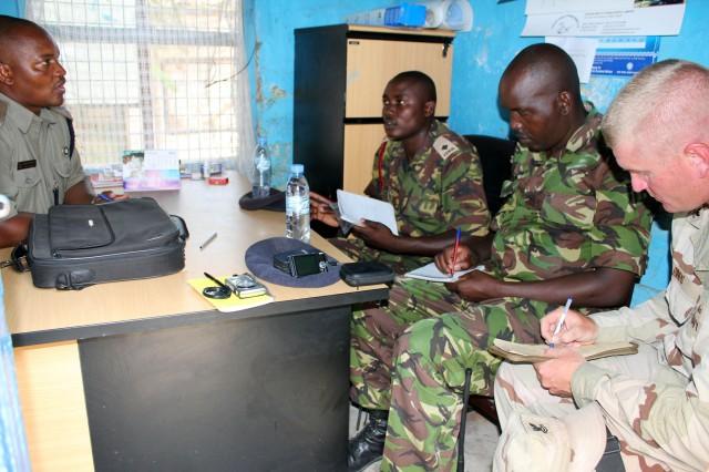 Kenyan and American military members plan an exercise during five weeks of civil-military operations training in Manda Bay, Kenya.