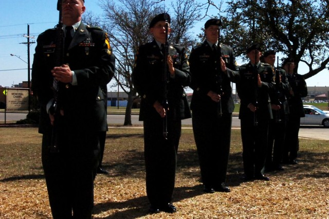 FORT HOOD, Texas - 2nd Brigade Combat Team, 1st Cavalry Division Soldiers stand render honors after a 21-gun salute in honor of Spc. Juan Ortega during a memorial service on Fort Hood, Texas, March 3.