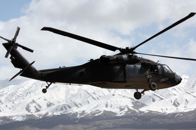A UH-60M Blackhawk helicopter from 4th Battalion, 101st Aviation Regiment, 159th Combat Aviation Brigade, flies alongside the snow-capped mountains of Shinkai district in southern Afghanistan on its way back to Kandahar Airfield following the unit's assumption of authority March 7 at Forward Operating Base Wolverine. 4th Bn., 101st Avn. Rgt., also known as Task Force Wings, is responsible for full-spectrum aviation operations throughout Zabul province. The unit is part of Task Force Thunder, which is deployed for a year providing aviation support throughout Regional Command South.
