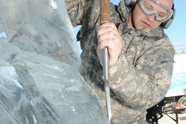 The Fort Sill Culinary Team's Sgt. 1st Class Daniel Martin uses a large chiesel to shape a block of ice.