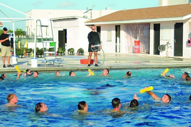 Students conduct remedial training in the pool after failing to meet standards for donning their equipment.