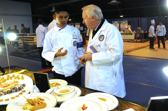 A judge at the 36th Annual Culinary Arts Competition, March 3-9, at Fort Lee, Va., provides a critique for a competition participant.