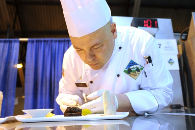 Cpl. Josh Hoyt prepares an Asian-themed dish as part of competition during the 36th Annual Culinary Arts Competition, March 3-9, at Fort Lee, Va.