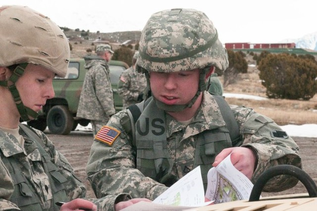 Pfc. Jared Campbell of the 786th Quartermaster Company looks over maps before starting the land navigation portion of the Best Warrior competition at Camp Williams, Utah, March 5, 2011. Army photo by Spc. Aloree Amodt, 358th Public Affairs Detachment.