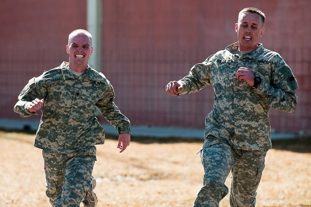 Spc. Stephen M. Parnell, a chemical operations specialist with the 423rd Transportation Company, and Sgt. Steven N. Fairbanks, a wheeled vehicle mechanic with the 786th Quartermaster Company, race to become the first to cross the finish line in the Army Physical Fitness Test's 2-mile run during the 96th Sustainment Brigade's Best Warrior competition at Camp Williams, Utah, March 4, 2011. Army photo by Spc. Kayla F. Benson, 358th Public Affairs Detachment.