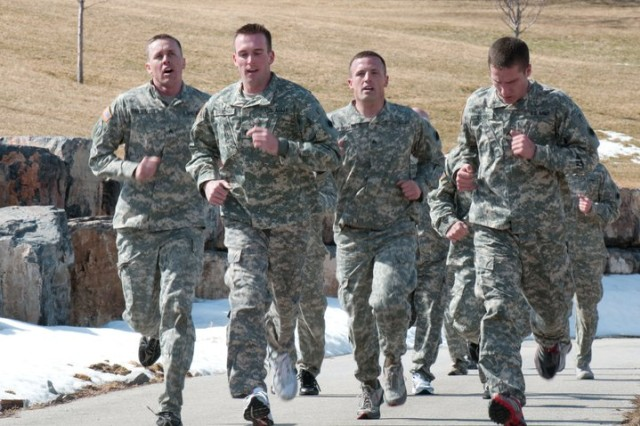 Soldiers competing in the 96th Sustainment Brigade's Best Warrior competition are challenged during the run; the soldiers did not have time to rest between events during the modified Army Physical Fitness Test. Staff. Sgt. Leith Strachan, left center, won the brigade's competition. Army photo by Sgt. Ruth Harvie, 358th Public Affairs Detachment.