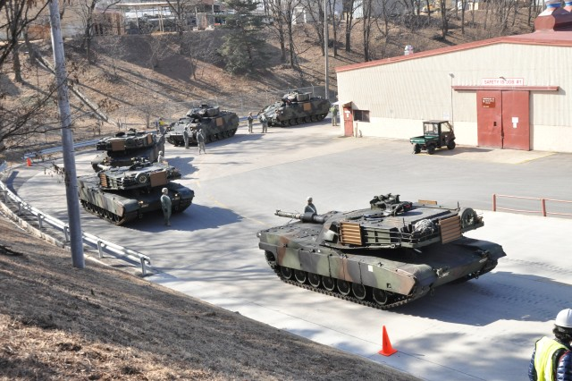 Soldiers from the 1st Squadron, 11th Armored Cavalry Regiment stage their vehicles for loading onto rail cars at Camp Carroll, South Korea Mar. 3, 2011. Soldiers from the 551st Inland Cargo Transfer Company helped ground  guide and load vehicles of the visiting units during rail-load procedures, prior to the vehicles being transported to the northern part of South Korea in support of exercise Foal Eagle 2011.