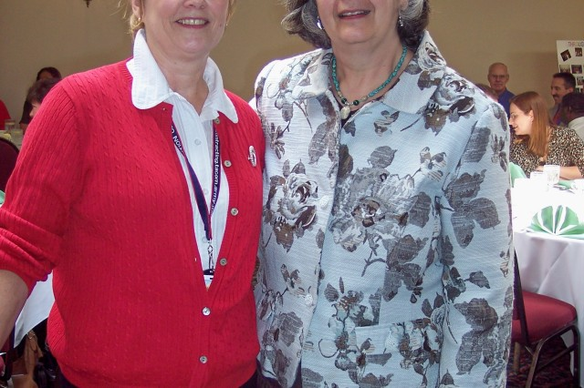 Close friend Sharlene Innes, left, congratulates Deborah Forbes on her retirement at a recent luncheon.