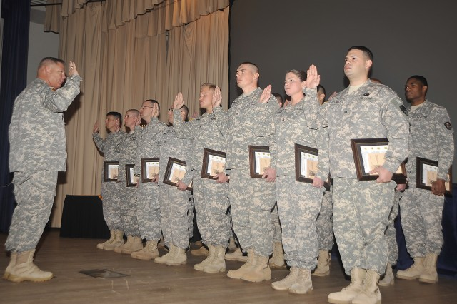 Command Sgt. Maj. William C. Baker, 1st Space Battalion, administers the charge of the noncommissioned officer to the 22 new NCOs inducted into the NCO corps. The induction ceremony was hosted by the 1st Space Battalion at Peterson Air Force Base, Colo.