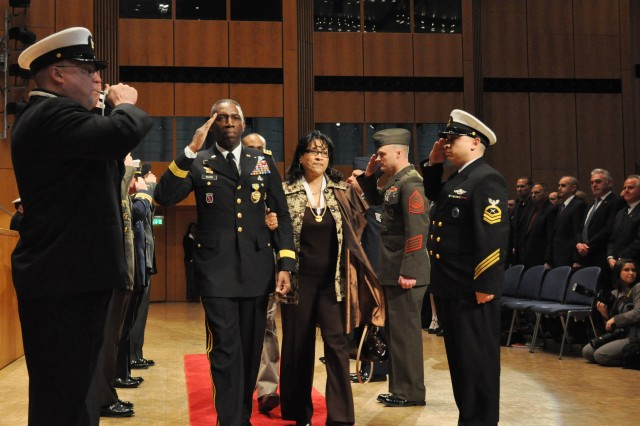U.S. Africa Command staff members pay special tribute as a final farewell to Gen. William E. Ward and his wife Joyce as they depart the U.S. AFRICOM change-of-command ceremony, March 9, 2011, at the Stadthalle in Sindelfingen, Germany.