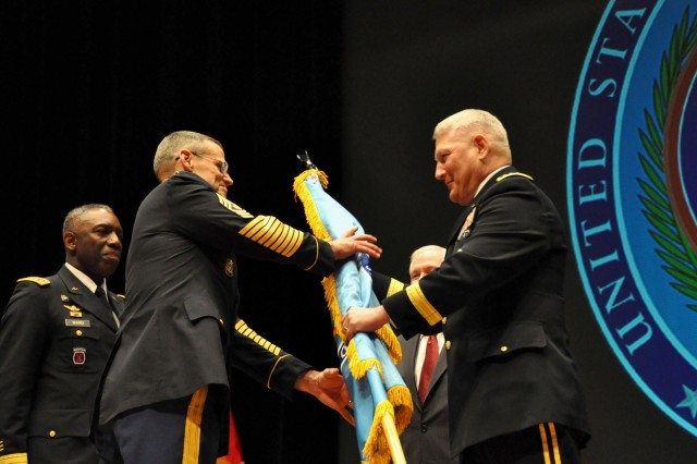 Command Sgt. Maj. Mark Ripka, U.S. Africa Command's senior enlisted leader, takes the U.S. AFRICOM guidon from Gen. Carter F. Ham during a change-of-command ceremony, March 9, 2011, at the Stadhalle in Sindelfingen, Germany. The passing of U.S. AFRICOM's colors symbolized Ham's acceptance of command from Defense Secretary Robert M. Gates, and Gen. William E. Ward's (left) relinquishment of command.