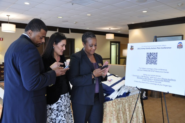 "FORSCOM G-1 officials embrace technology by using their smart phones to search for ""QR Code readers"" that allows them to retrieve a link, embedded within a ""QR code,"" that directs users to an online source of 2011 FORSCOM AFAP conference news. FORSCOM is hosting its AFAP conference from March 7-11, in Atlanta."