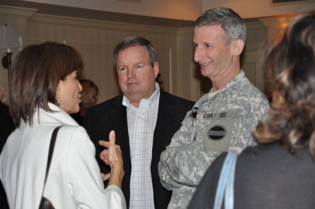 "FORSCOM Deputy, Chief of Staff G-1 Mr. Eric ""Rick"" Porter, FORSCOM Deputy Commander Lt. Gen. Howard B. Bromberg, and a conference participant engage in conversation during the 2011 AFAP conference social hour. The social hour gives delegates a chance to unwind from the days stress and mix and mingle with each other and FORSCOM officials."