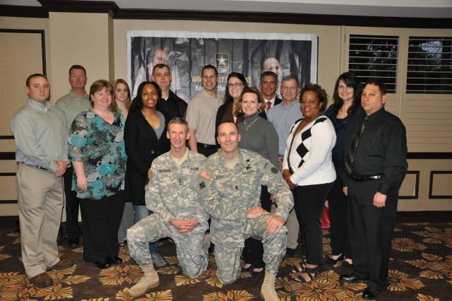 During the 2011 AFAP social hour conference delegates were able to mix and mingle with each other and FORSCOM officials.  FORSCOM Deputy Commander Howard B. Bromberg and Command Sergeant Major Ronald Riling are pictured with the Benefits & Entitlements work group
