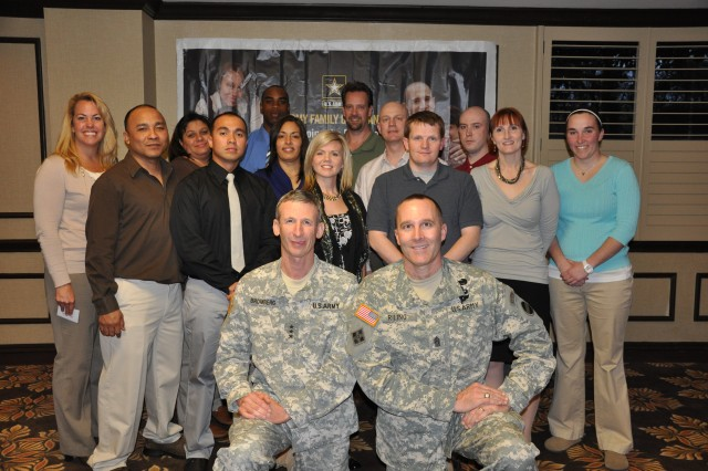 During the 2011 AFAP social hour conference delegates were able to mix and mingle with each other and FORSCOM officials.  FORSCOM Deputy Commander Howard B. Bromberg and Command Sergeant Major Ronald Riling are pictured with the Force Support work group.