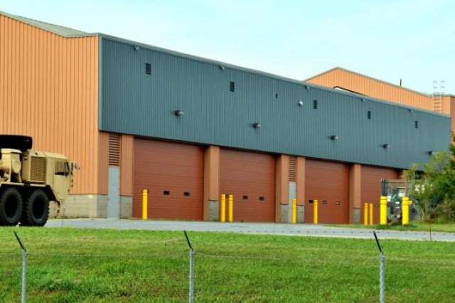 This Fort Drum motor transport shop is one of several on 5th Armored Division Drive equipped with solar air-heating technology. The blue-grey paneled Solar Walls were installed facing south to absorb as much sun as possible during the winter.