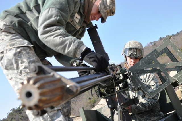 Cpl. Ryan Kelly (left) and Spc. Matthew Boulton assemble a M-2 machine gun during training as part of Exercise Foal Eagle 2011 in Busan, South Korea.  Both Soldiers are assigned to the 551st Inland Cargo Transfer Company, 498th Combat Sustainment Support Battalion, 501st Sustainment Brigade.