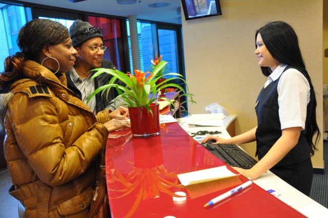 Katja Watson (right) checks in Robert and Dorothy Williams at the new Wiesbaden Army Lodge in Hainerberg Housing Jan. 29. The Williams were transitioning from the GrafenwAfAPhr military community to Wiesbaden.